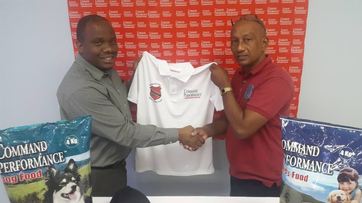 Brand Manager of National Flour Mills Kevon Fields, left, presents  president of the TT Umpires and Scorers' Council Parasram Singh with a Command Performance sponsorship package to outfit officials for the 2019 TTCB cricket season. PHOTO COURTESY TTCB