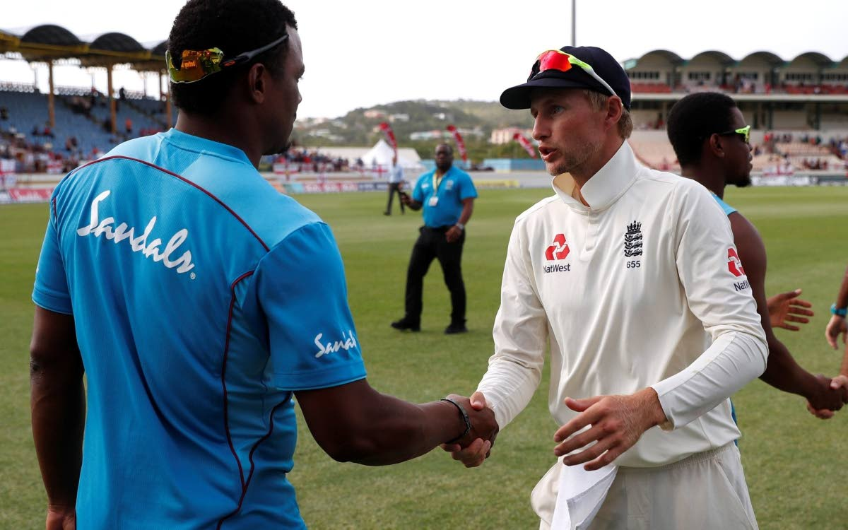 Windies pacer Shannon Gabriel, left, shakes the hand of England captain Joe Root after the 3rd Test in St Lucia recently.