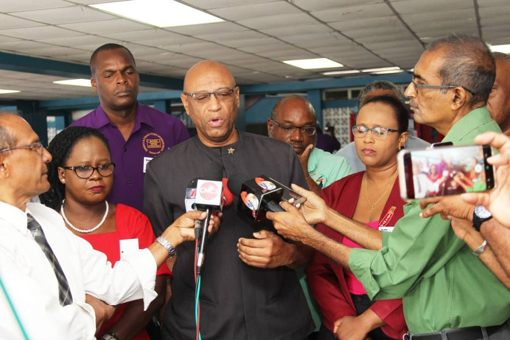 Joint Trade Union Movement president Ancel Roget, addresses the media ahead of the group's biennial conference at Paramount Building, San Fernando.