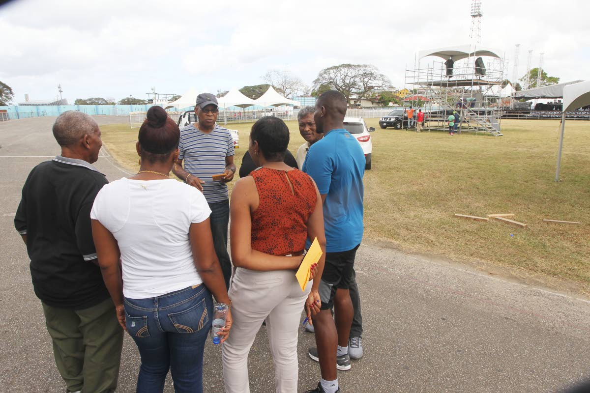 Tennis coach Anthony Cook, background, speaks to other members of the sporting fraternity who will be affected by a notice to leave Skinner Park by March 6 to facilitate upgrade work. PHOTO BY LINCOLN HOLDER