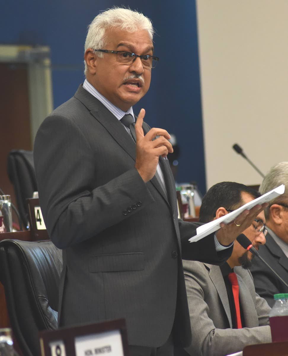 Health Minister Terrence Deyalsingh addresses the House on Friday. PHOTO BY KERWIN PIERRE