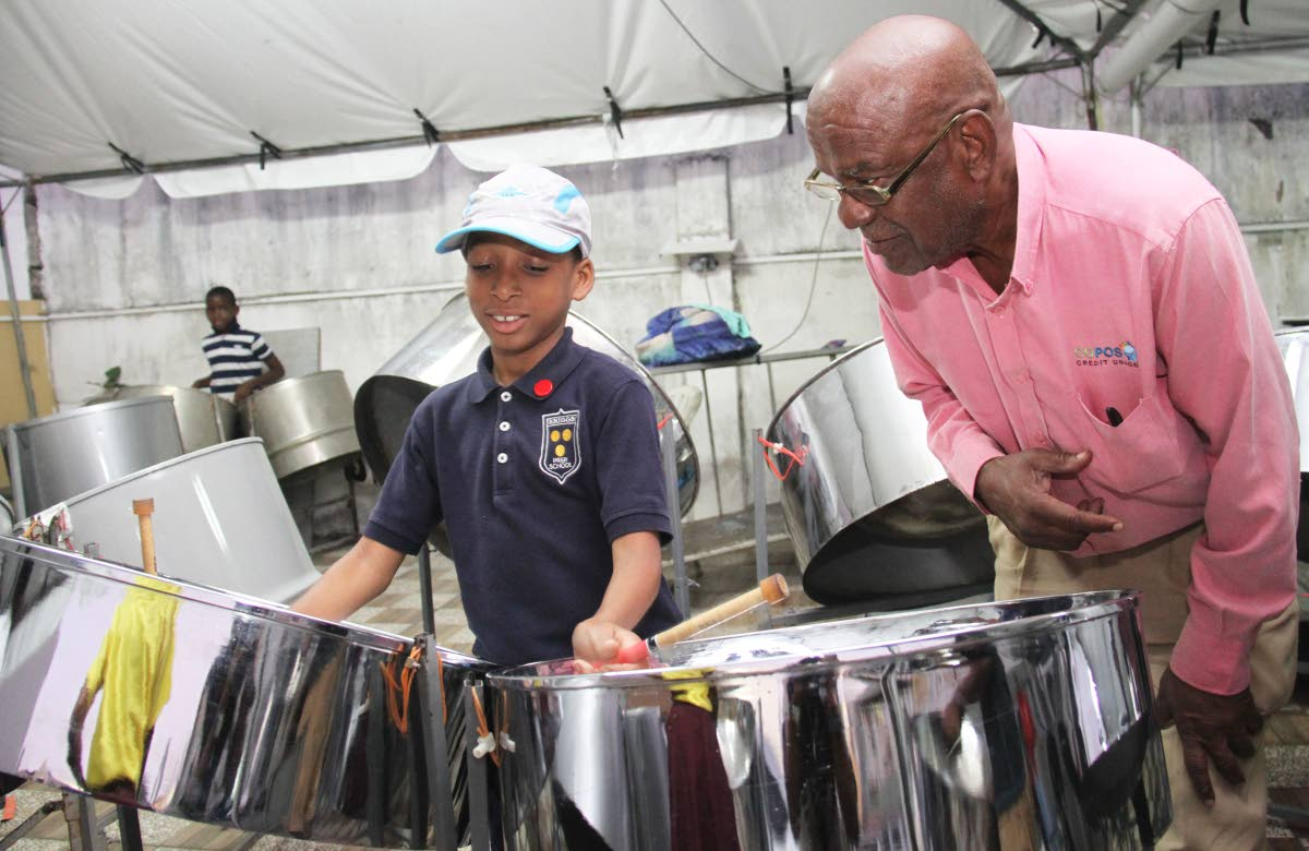 Jalon James plays the double tennor while Flabej director John Douglas looks on, at their Pembroke Street, Port of Spain panyard. PHOTO BY AYANNA KINSALE