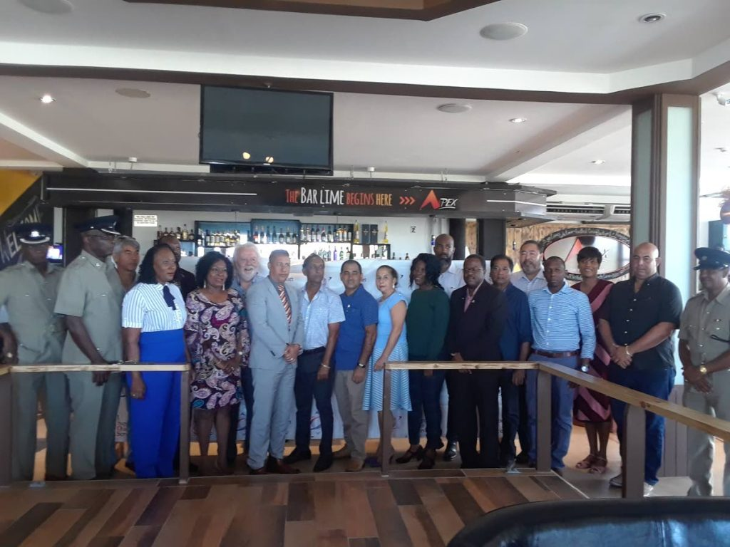 Police Commissioner Gary Griffith, eighth from left, stands with senior officers of the Tobago Division of the TT Police Service, and members of the business community at the launch of the I Support Our Service (ISOS), at the Apex Bar and Grill in Bon Accord, on February 8.