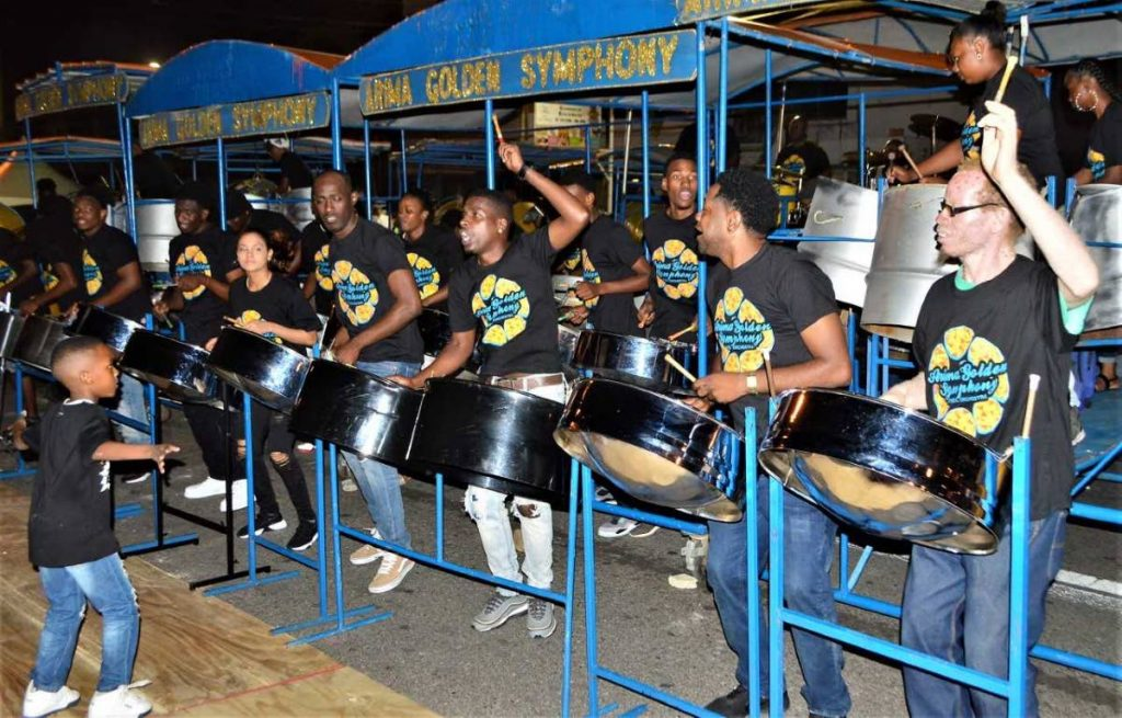 ON TO THE FINALS: Arima Golden Symphony with their six-year old conductor, left, placed second behind TT Defence Force in the Panorama small bands semis held on Saturday at Victoria Square in Port of Spain. PHOTO BY  GARY CARDINEZ