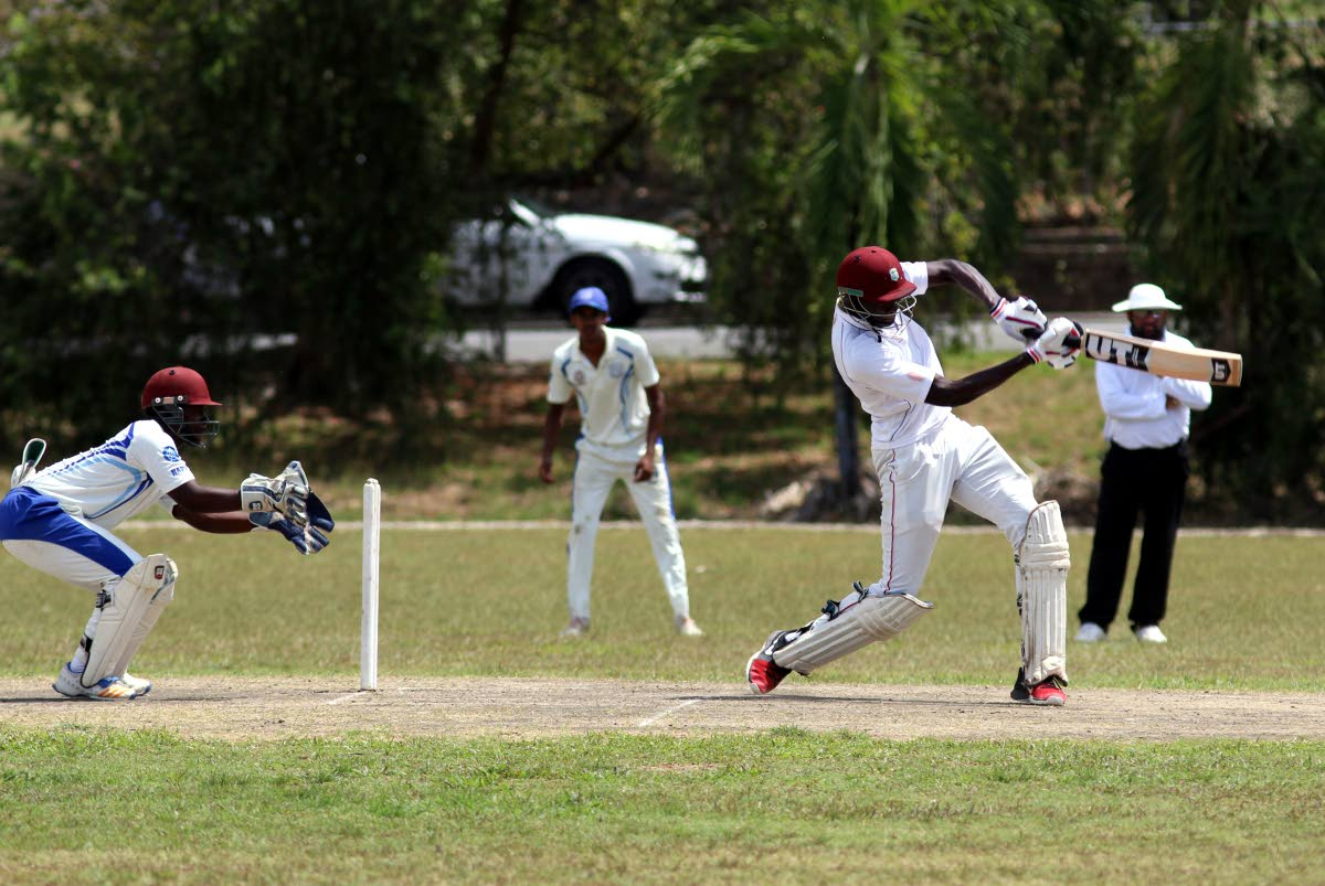 St Benedict's Joshua James on the attack against Naprima College in the Powergen Secondary Schools Cricket League yesterday at Lewis Street, San Fernando.
