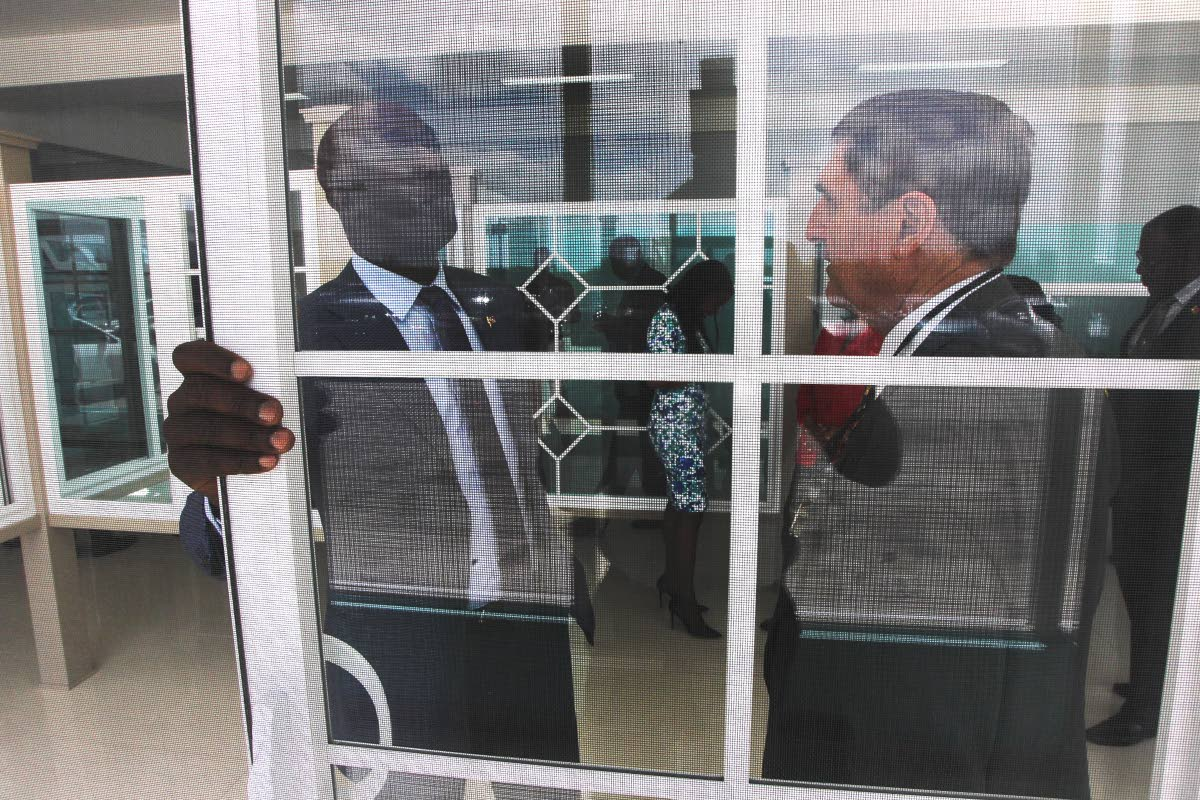 Prime Minister Dr Keith Rowley chatting with CEO of Domus Caribbean uPVC Solutions, Terrence Ortt following the official launch of the faciility at Factory Road, Chaguanas. Photo by Lincoln Holder