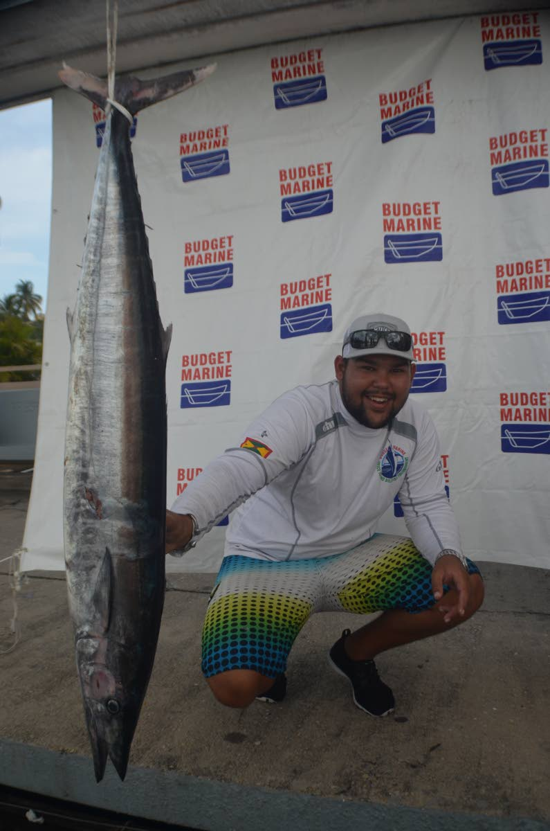 BEST ANGLER: Joshua Camacho of Team Bless with his 31-pound wahoo caught over the weekend. PHOTO BY RONALD DANIEL