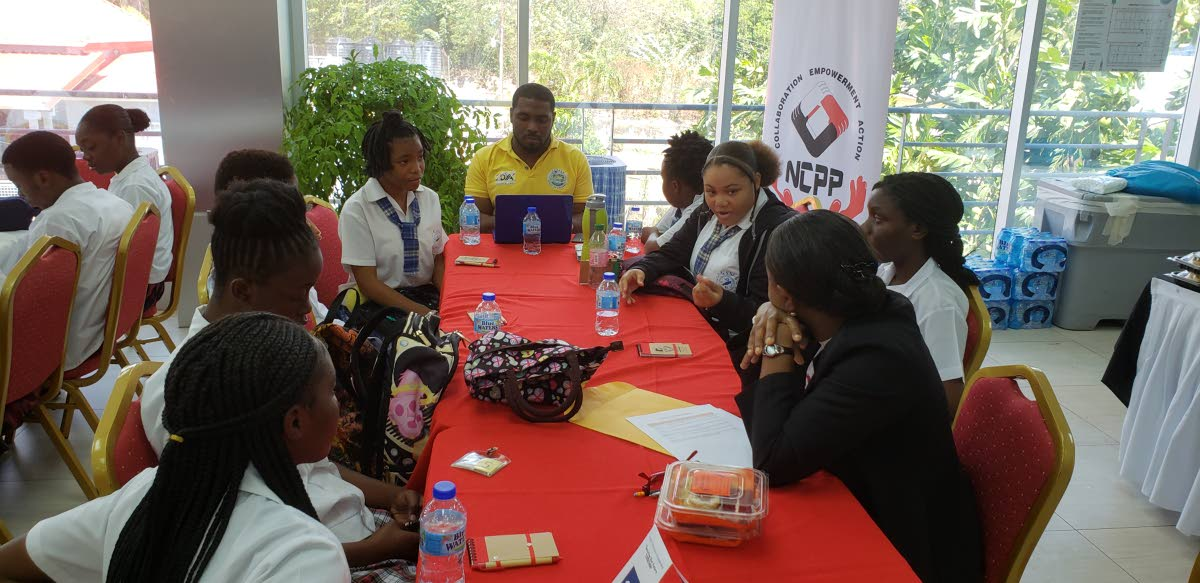 Students and teachers engage in discussions at Tuesday's NCPP Youth Outreach Engagement at the Conference Room of the Division of Community Development at Glen Road, Scarborough.