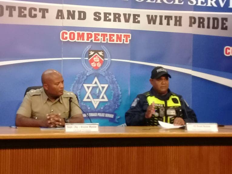 File photo: Acting Supt for the Central Division Wayne Mystar, left, looks at Police Road Safety Coordinator Constable Brent Batson during a media briefing at the Police Administration building, Sackville Street, Port of Spain.