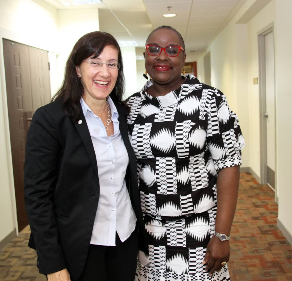 File photo: Minister of Planning and Development, Camille Robinson-Regis, right, with Marina Walter the UN co-ordinator for TT.