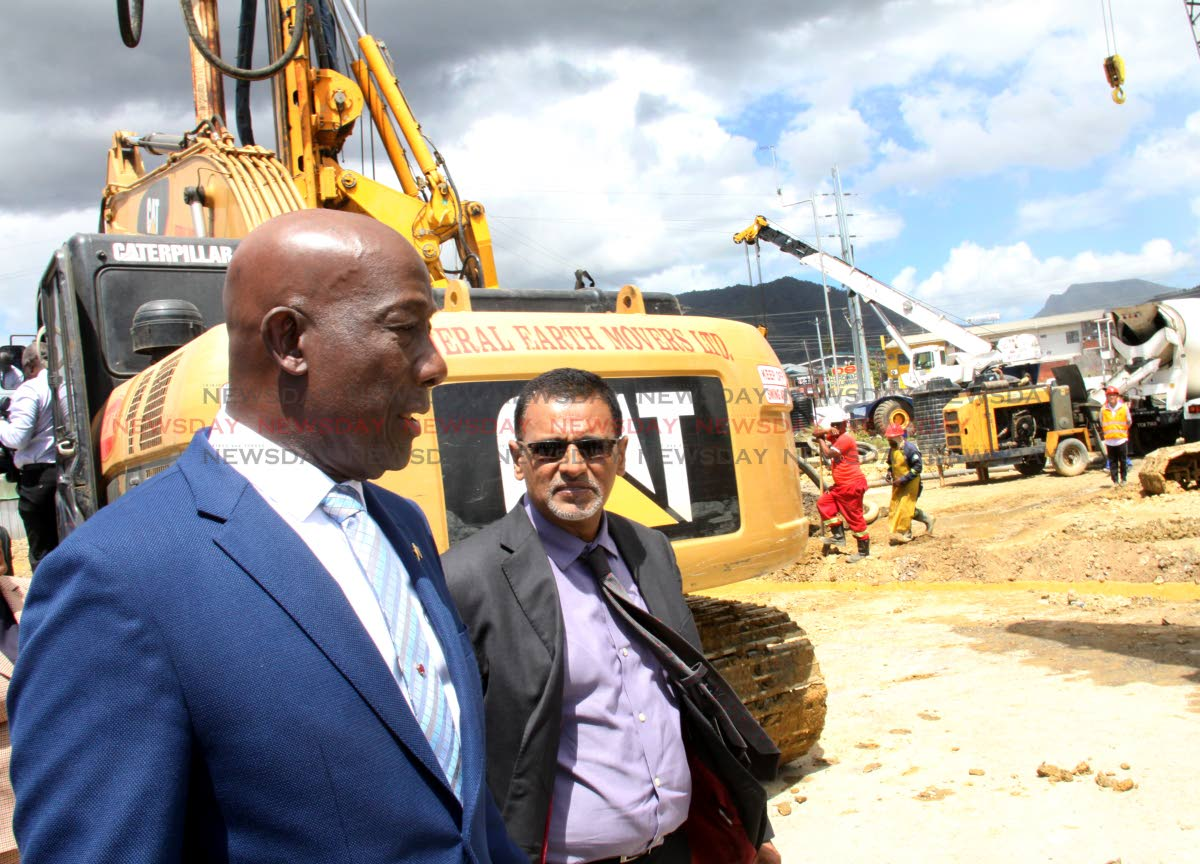 GREEN LIGHT: Minister of Works and Transport Rohan Sinanan, right, and Prime Minister Dr Keith Rowley tour the Curepe Interchange Project after the sod-turning ceremony, yesterday. PHOTO BY ANGELO MARCELLE