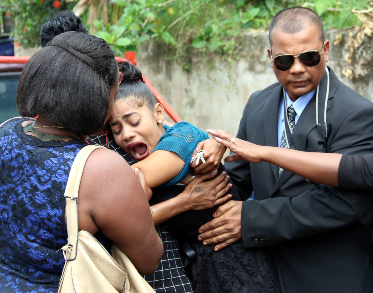 A MOTHER'S PAIN: Maria Granger screams her sorrow yesterday at  the funeral for her three-year-old son Prince who was burnt to death  last Friday.