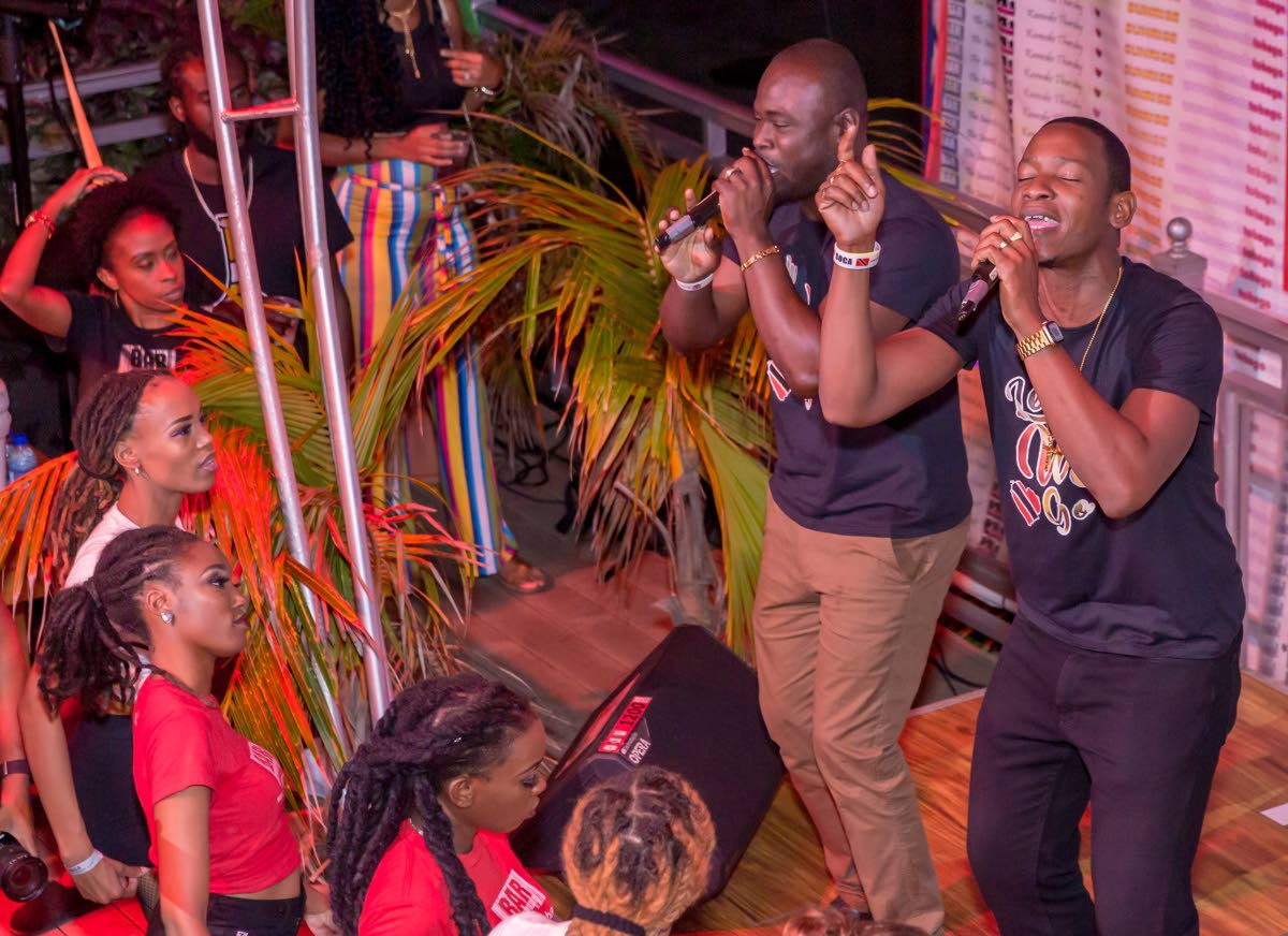 Jason George, left, and Darren Thomas perform their hit song, Come Leh We Go, at the I Love Soca event hosted by Barcode on  Milford Road, Scarborough, on Tuesday.   PHOTO BY DAVID REID