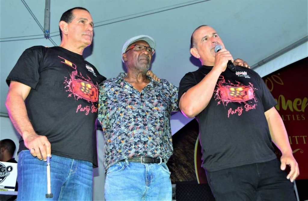 """Arranger Len """"Boogsie"""" Sharpe with John and Robert Hadad on stage on Wednesday night at Phase II Pan Groove 's corporate lime at its panyard, Hamilton  Holder Street in Woodbrook."""