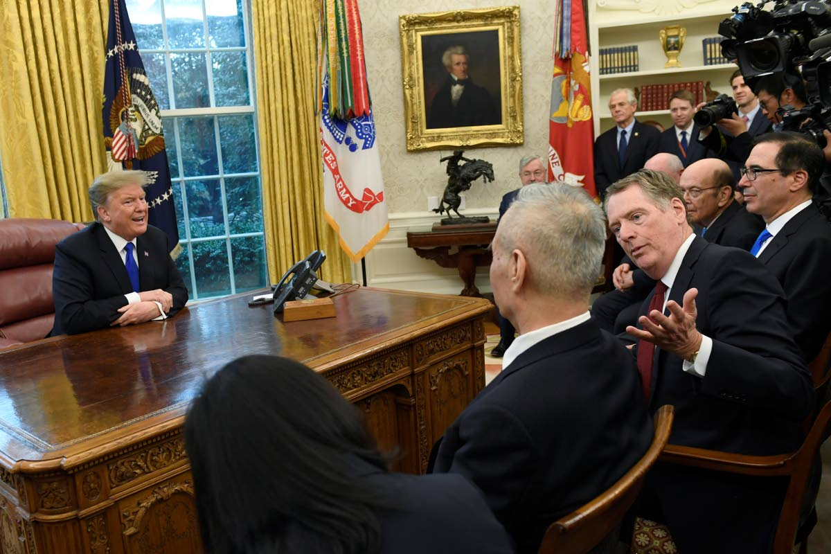 TRADE TENSIONS: US President Donald Trump, left, and US Trade Representative Robert Lighthizer, second from right, talk with Chinese Vice Premier Liu He, second from left, during their meeting in the Oval Office of the White House in Washington last Friday.