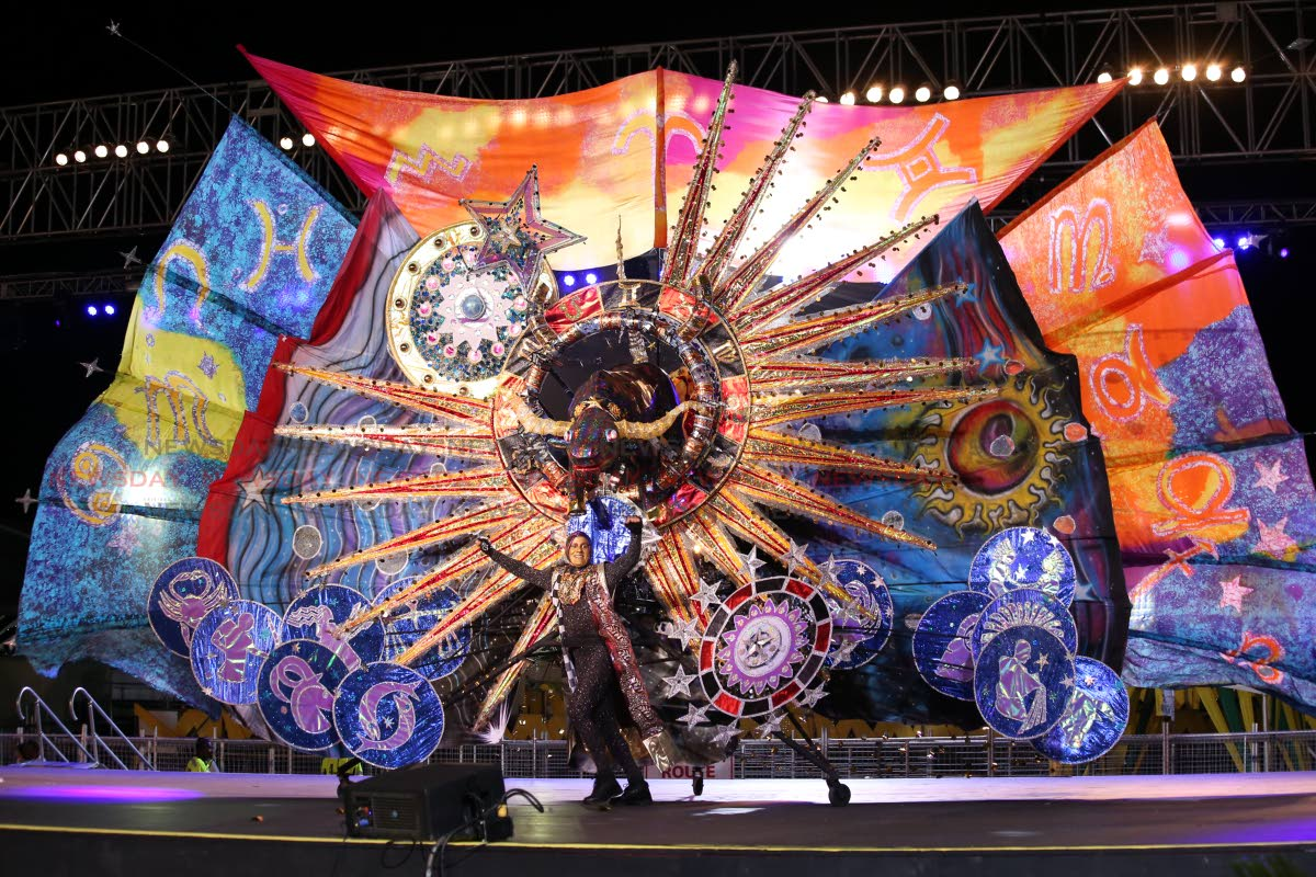 MAS MAS: Nigel Baptiste portrays his costume Taurus Raging Through the Fields of the Universe during the King of Carnival preliminaries at the Queen's Park Savannah on Thursday.