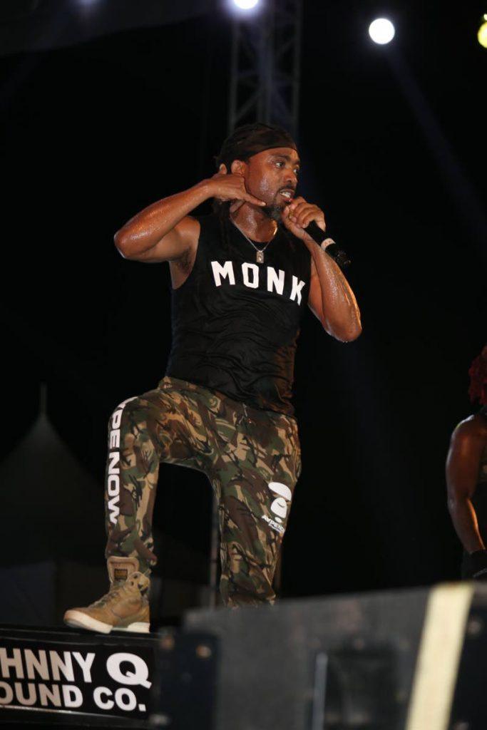 Machel Montano, at Army Fete on Friday, made a call for the crowd to convince Iwer George to perform at his Machel Monday concert. PHOTO BY JEFF MAYERS