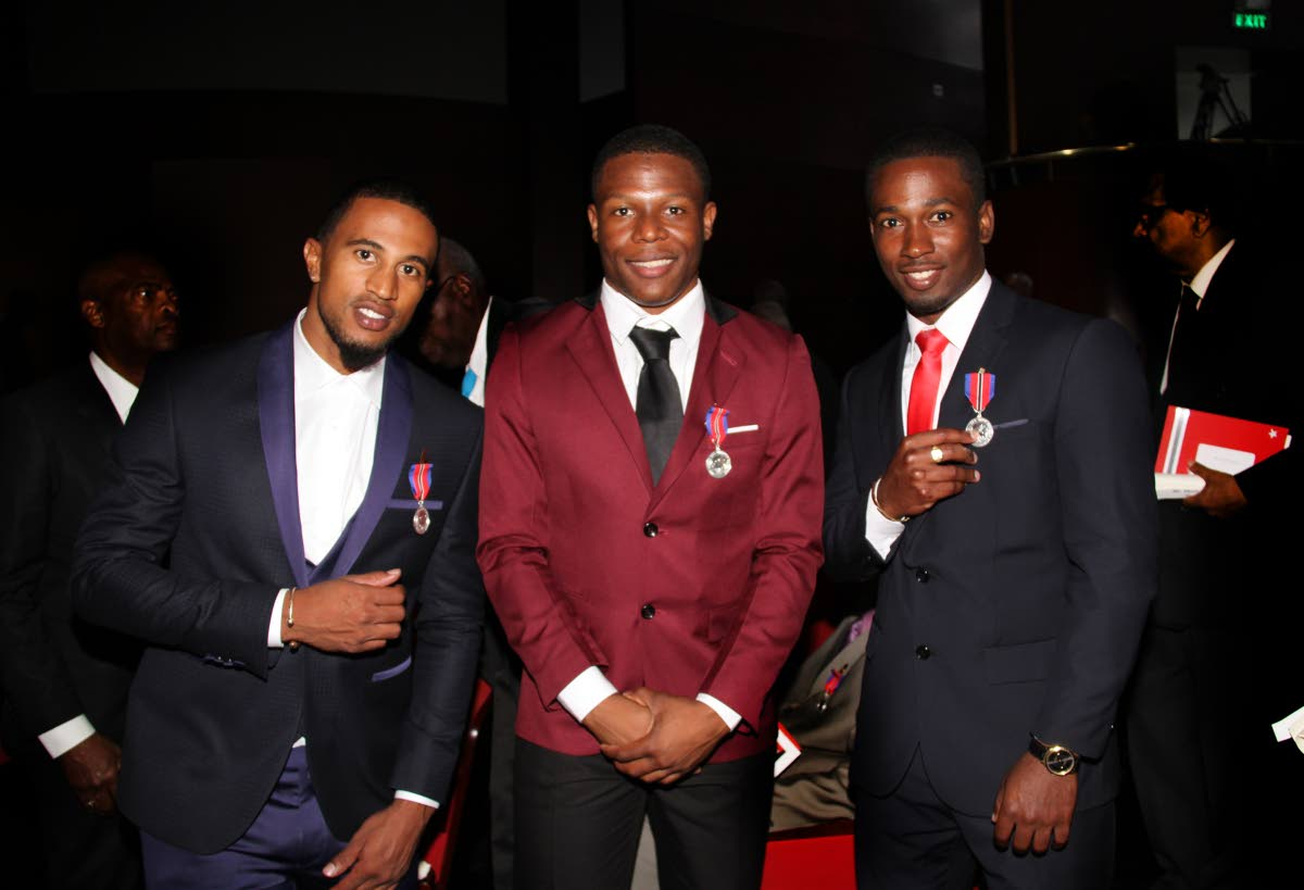 TOP RIDERS: National cyclists (from left) Njisane Phillip, Nicholas Paul and Kwesi Browne, with their Humingbird Silver medals at the National Awards last year.