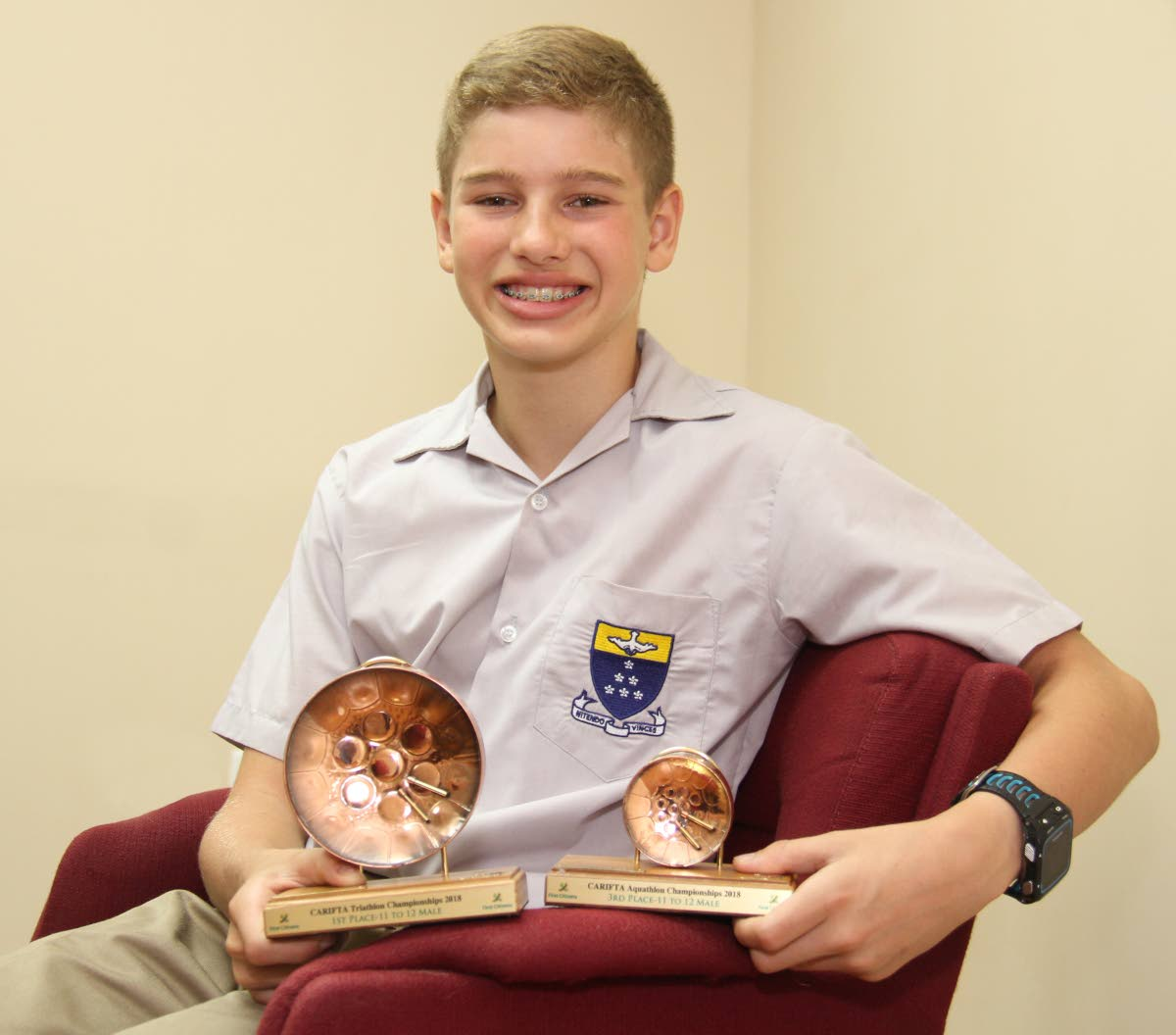 James Castagne-Hay with trophies won at the 2018 Carifta Triathlon and Aquathlon Championships. PHOTO BY ROGER JACOB