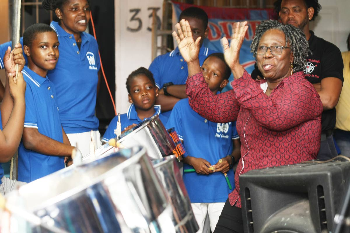 Pan Trinbago president Beverly Ramsey-Moore with young players of Edinburgh 500 steel ensemble during the qualifying round of single pan judging on January 23. FILE PHOTO