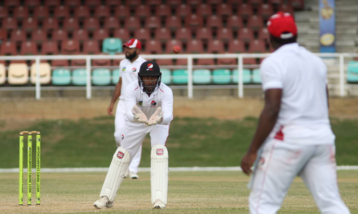 In this February 2 file photo, TT Red Force captain Denesh Ramdin catches the ball from a fielder during their encounter against the Guyana Jaguars at the Queen's Park Oval, St Clair.