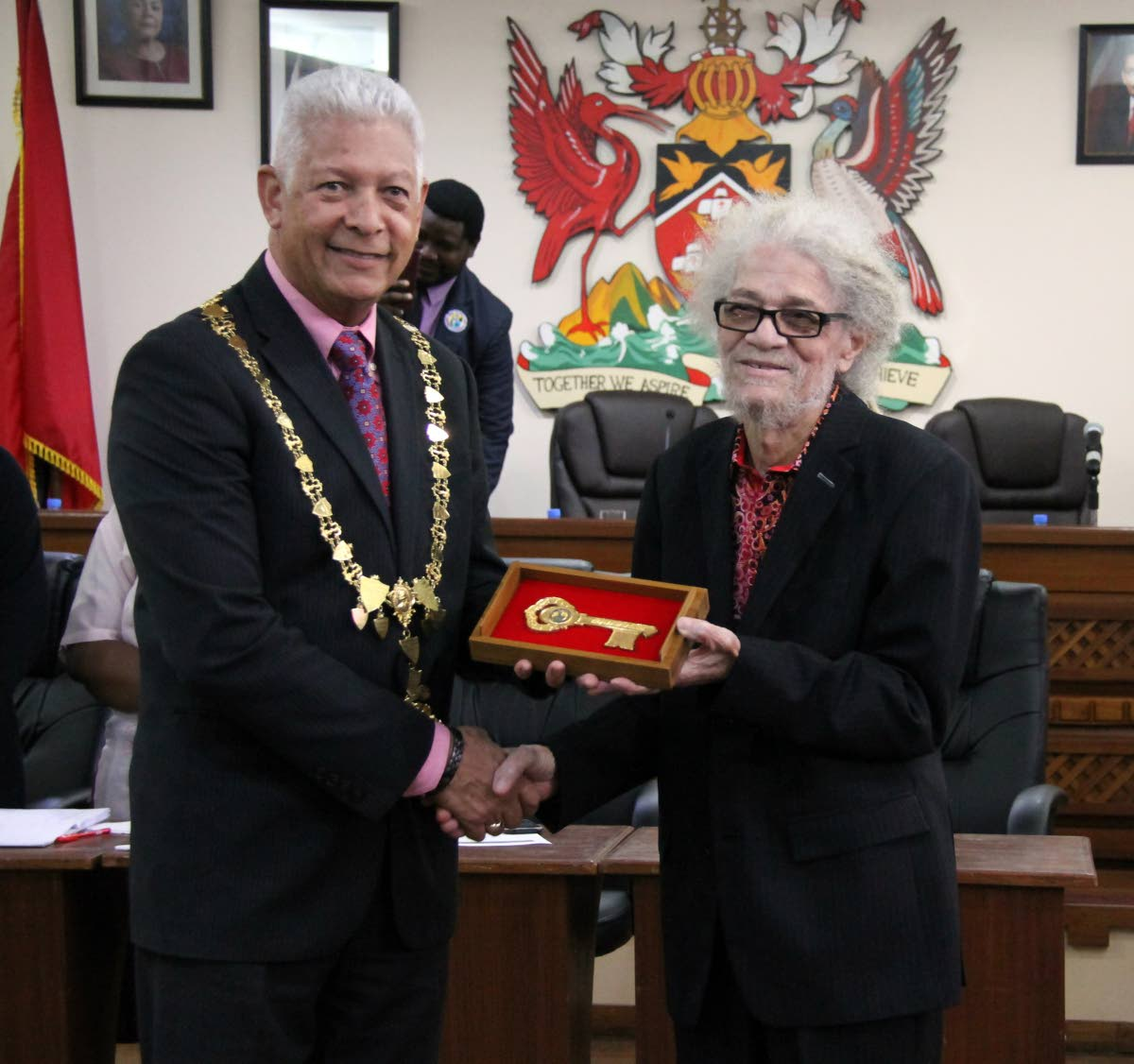 Musician Roy Cape, right, receives the keys to the city of Port of Spain from Mayor Joel Martinez at City Hall on February 8.  File photo