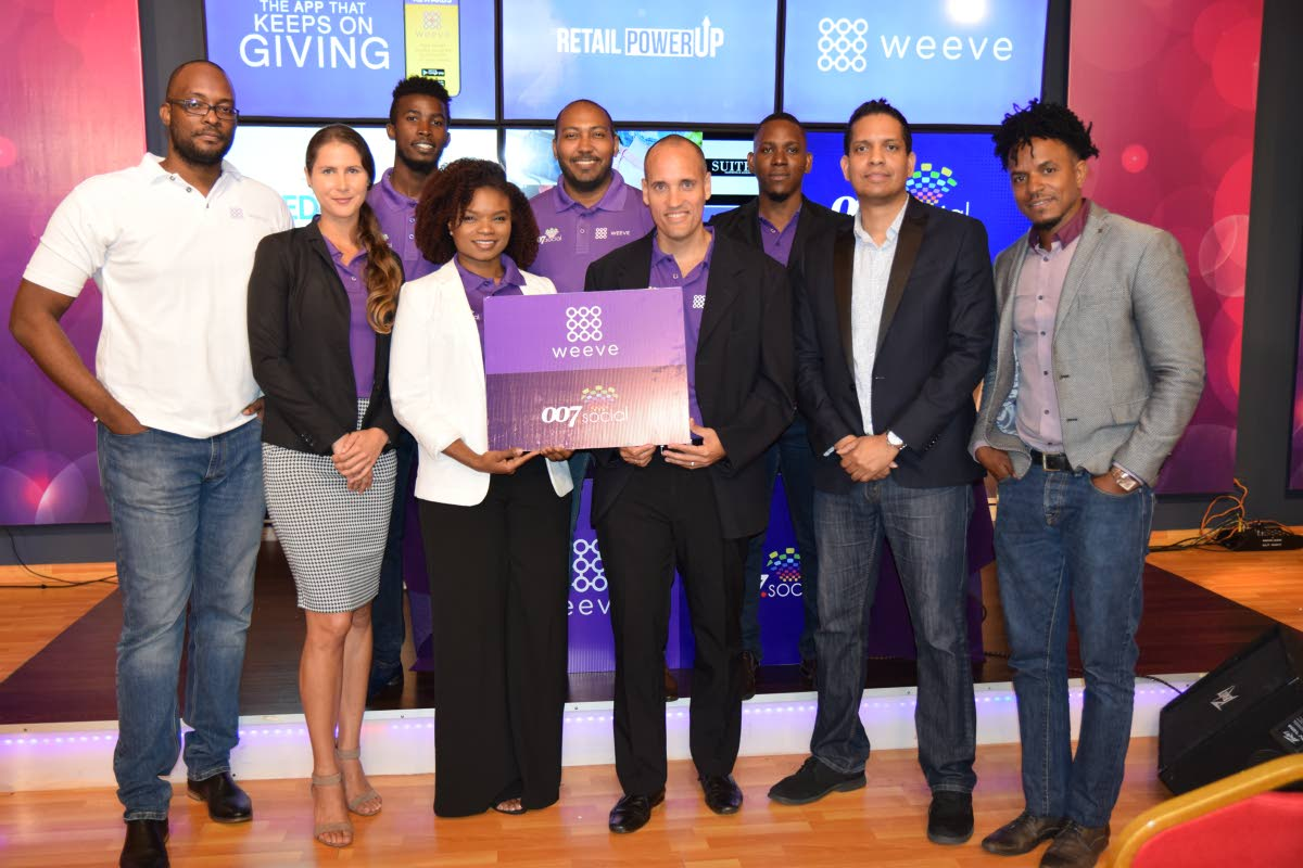 Khari Goddard (front row, from left), solutions engineer, Weeve; Gabrielle Duval, Weeve sales manager; Chrystal Martin, social strategist at 007.Social; Weeve founder Richard Marshall; Kirwin Narine, founder of 007.Social; and Dual Point System founder Marlon Grant. Standing in the back are Shaquille John, Weeve sales agent; Clint Cielto, marketing and business development; Justin Scipio, Weeve's chief performance officer; and Gabrielle Duval, client relations, Weeve.