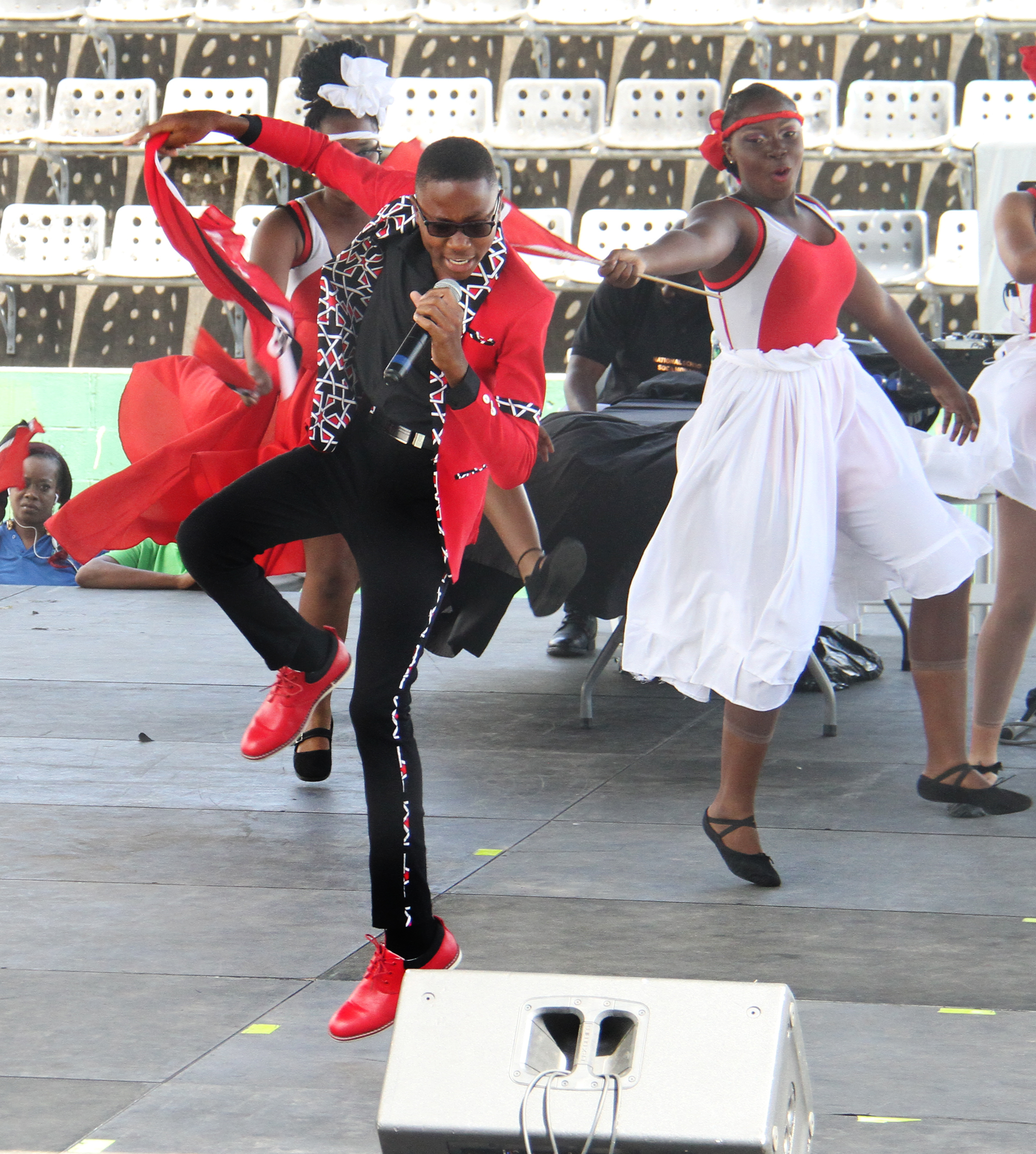 Stefan Camejo of St Francois Boys' College, Belmont, performs his winning song Raise Up at the National Schools' Soca Monarch held at the Jean Pierre Complex yesterday.