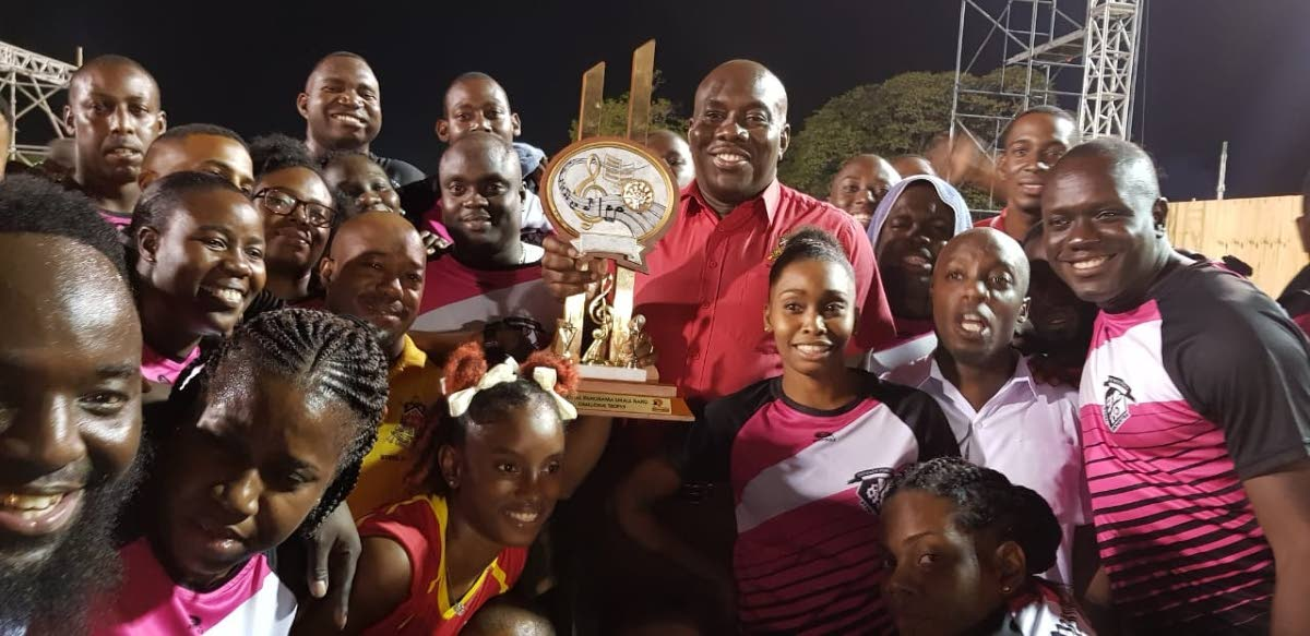 Sheldon Montique, TT Defence Force band manager, centre, celebrates with his members on the skinner park stage victory in the panorama finals small band category in the early hours of Friday morning. PHOTO BY YVONNE WEBB