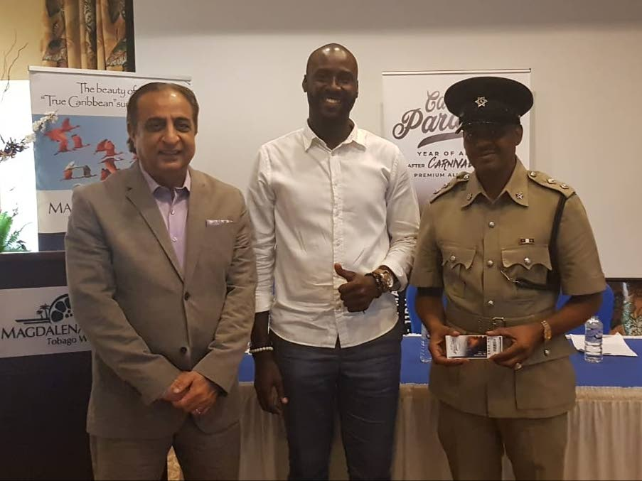 Erlan Clarke (centre), of Opulence Promotions and Events Management, presents ten Call to Paradise tickets to ASP David Powder (right). Looking on is general manager of Magdalena Grand Beach and Golf Resort, Vinod Bajaj.