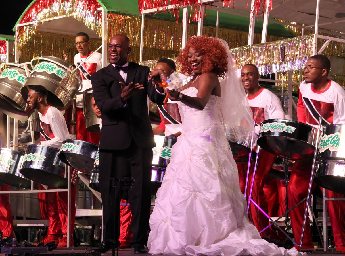 "2019 Champion Renegades arranger Duvone Stewart brings his ""bride"" on stage as the band performs Farmer Nappy's Hookin Meh on its way to its 11th Panorama title on Saturday night at the Queen's Park Savannah in Port of Spain. PHOTO BY ROGER JACOB"