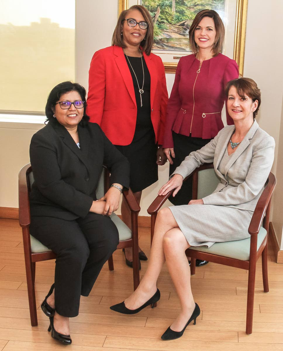 BPTT's top executives: Seated are Camille Boodhai-Kangal, regional director, procurement and supply chain management, left, and Claire Fitzpatrick, regional president. Standing are Wendy Fae Thompson, managing counsel, left, and Giselle Thompson, vice president, corporate operations. PHOTOS BY AYANNA KINSALE
