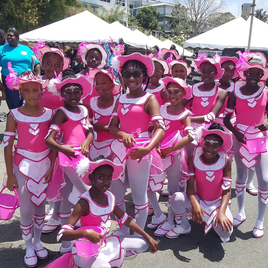 Young masqueraders of the Lover's Bay section of Enchanted Waters get ready to hit the streets of Scarborough during Saturday's Junior Carnival Parade of the Bands.