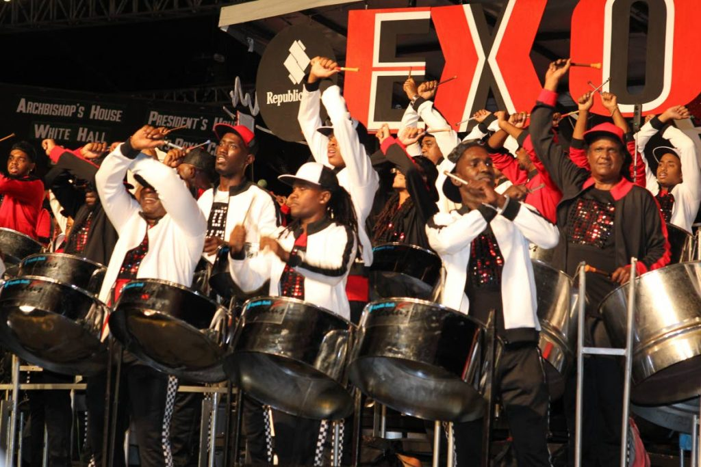 Members of Exodus Steel Orchestra enjoy themselves as they play Kees Diefenthaller's Savannah Grass in the large band Panorama finals in Queen's Park Savannah, Port of Spain on Carnival Saturday. PHOTO BY ROGER JACOB