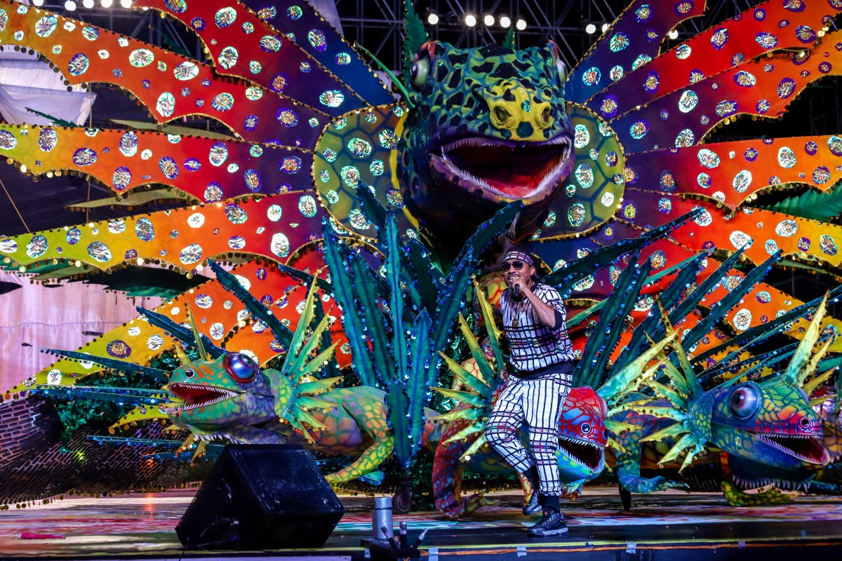 Machel Montano performs as Savitri Holassi portrays her Carnival queen costume Night of the Chameleon Queen  at the Dimanche Gras showon Sunday at the Queen's Park Savannah, Port of Spain. dd:2019.03.03