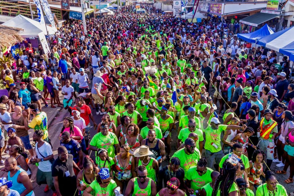 Fog Angels J'Ouvert revellers make their way through Crown Point. PHOTO BY DAVID REID