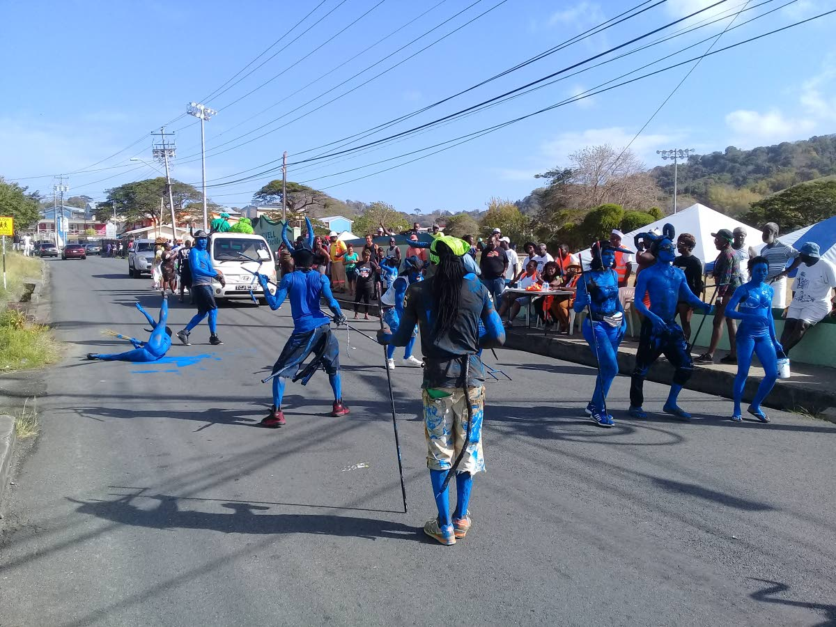 Pioneers of Calder Hall blue devils in J'Ouvert revellery on Carnival Tuesday. The group celebrates on Tuesday and not on Carnival Monday. FILE PHOTO