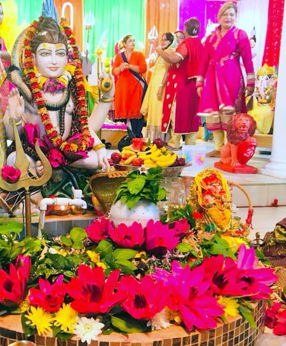 DEVOTIONS: Flowers adorn the Shiva murti at the Krishna Temple in Princes Town during Maha Shivratri devotions on Monday night.