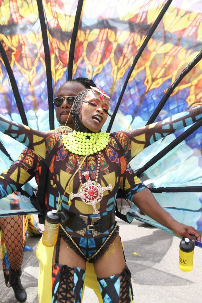 WINNING FUN: A masquerader enjoys Carnival Tuesday mas in the band K2K whose presentation Through Stained Glass Windows was adjudged Overall Band of the Year. PHOTO BY SUREASH CHOLAI