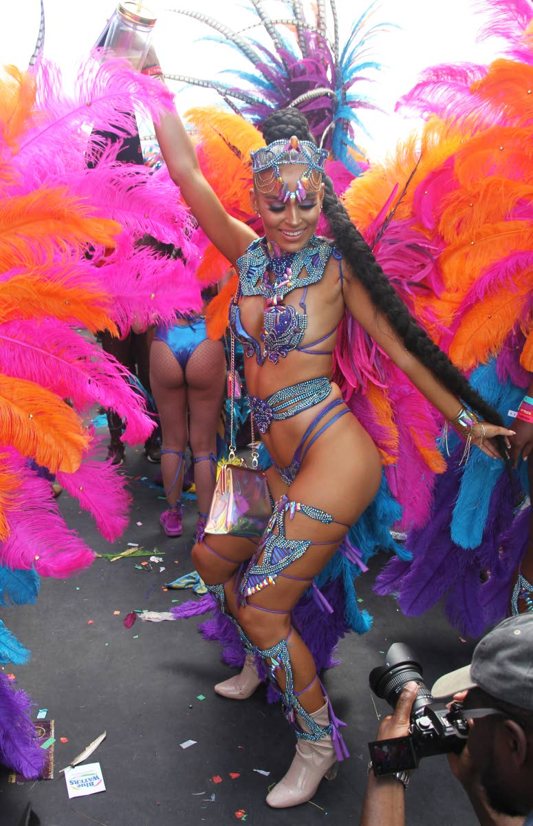 A Tribe masquerader savors the revellery at Socadrome, Jean Pierre Complex, Port of Spain on Carnival Tuesday. PHOTO BY AYANNA KINSALE