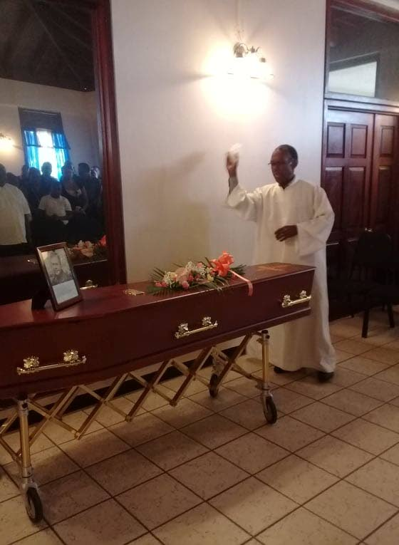 FINAL RITES: Brother Gregor Florence blesses the casket of former newspaper editor Carl Jacobs during the funeral service for him held at the St James Crematorium on Wednesday.