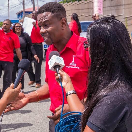 TTUTA Tobago Officer Orlando Kerr speaks to the media outside Signal Hill Secondary last year. PHOTO BY DAVID REID