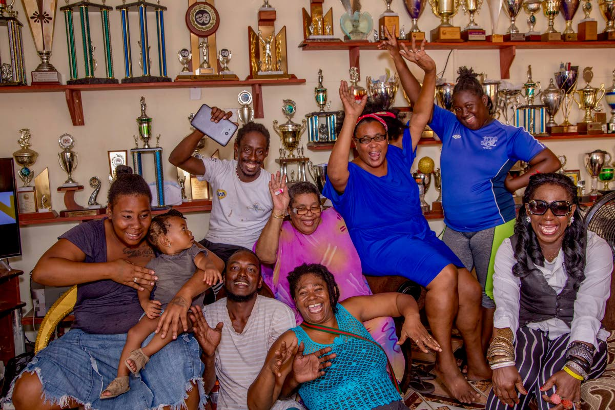 SWEET VICTORY: Stoute Next Generation members celebrate with Gloria Stoute, seated centre, whose Stoute and Associates band gave birth to Stoute Next Generation seven years ago. PHOTO BY DVAID REID