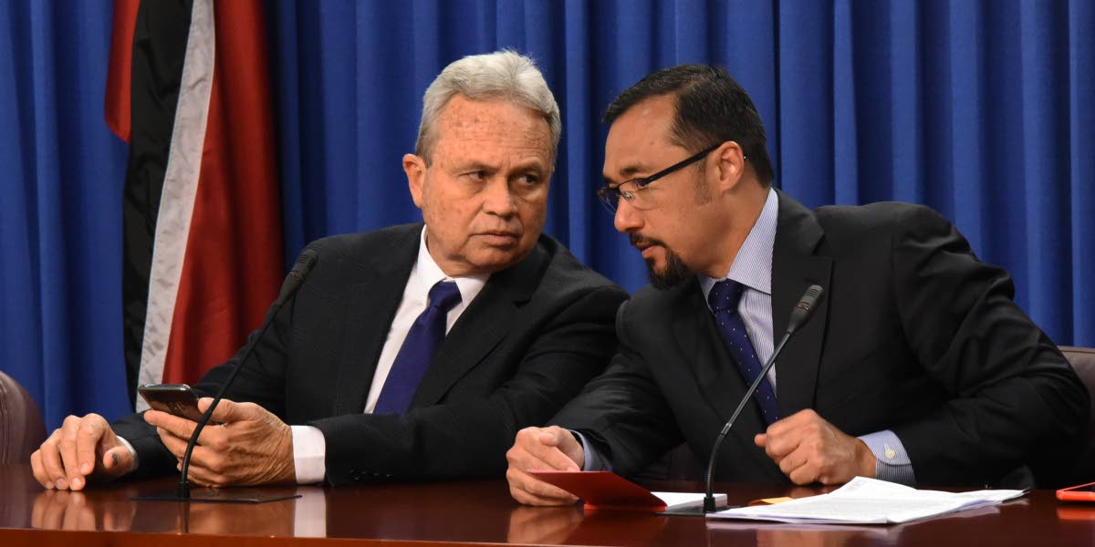 HERE'S WHAT TO SAY: Acting Prime Minister Colm Imbert, left, speaks with National Security Minister Stuart Young yesterday at the post Cabinet press briefing at the Diplomatic Centre in St Ann's. PHOTO BY KERWIN PIERRE