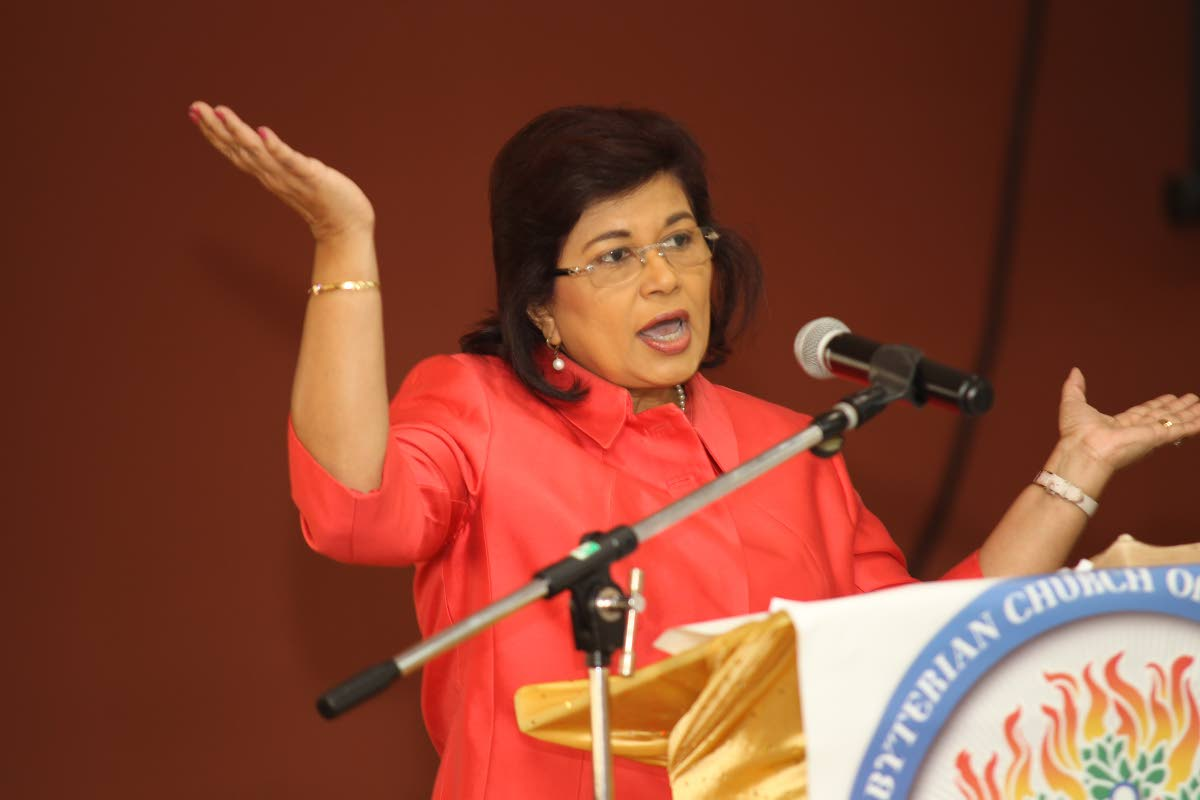 Leader of the Congress of the People Carolyn Seepersad-Bachan gestures as she addresses the International Women's Day forum on Friday at the Susamachar Presbyterian Church, San Fernando.