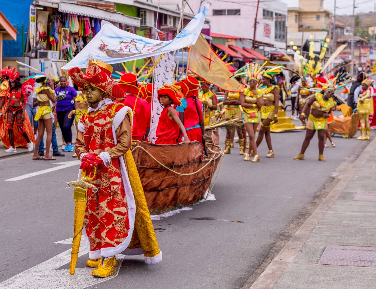 Masqueraders from the Tobago Guild's presentation, Oro: The Story of Gold, cross the stage on Carnival Monday in Scarborough. PHOTO BY DAVID REID