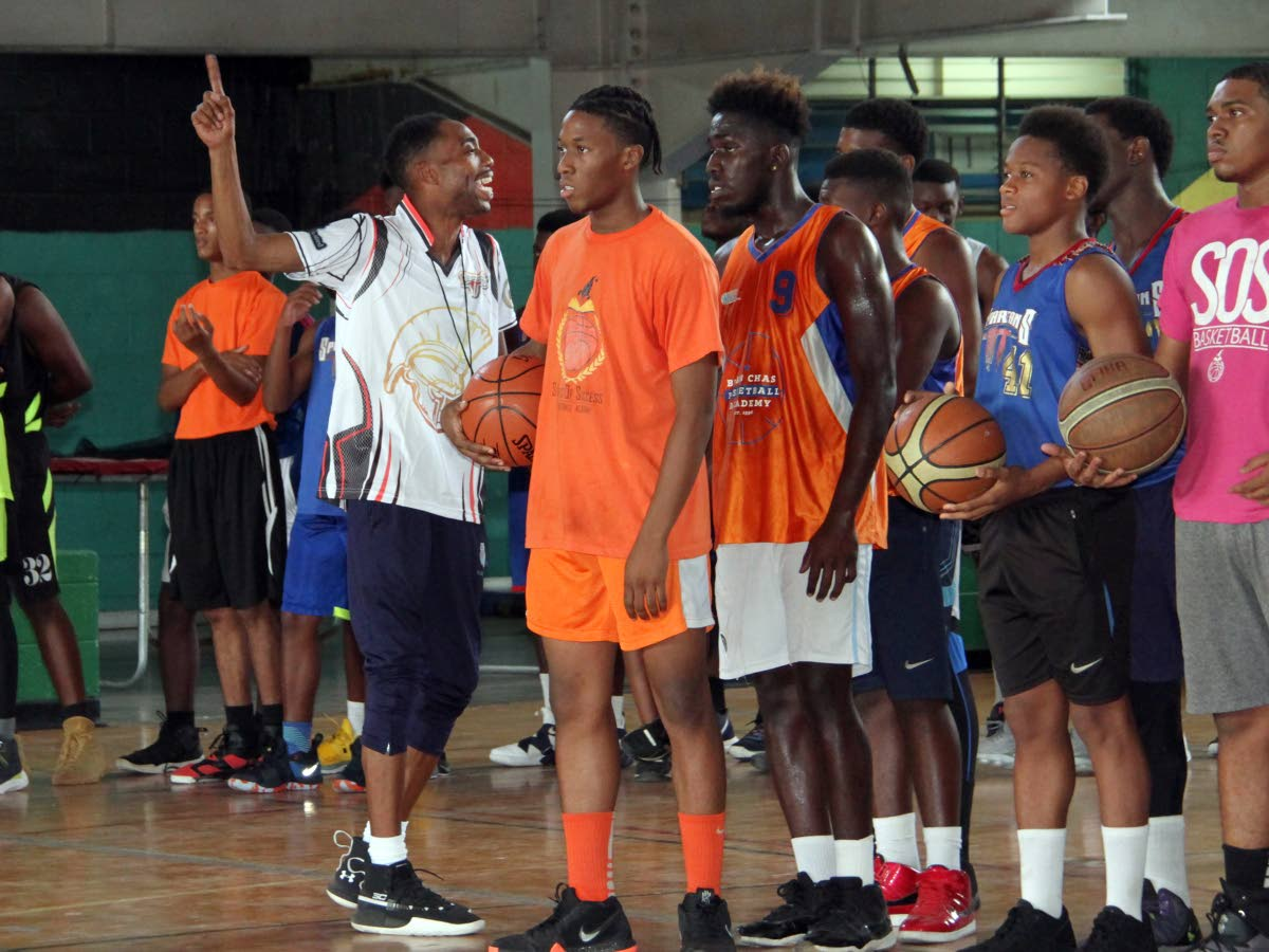 Coach Mark Cook (L), of the United States, talks to participants of the Spartans TT March Mayhem Skills Clinic 2019, yesterday, at the Jean Pierre Complex, Port of Spain.