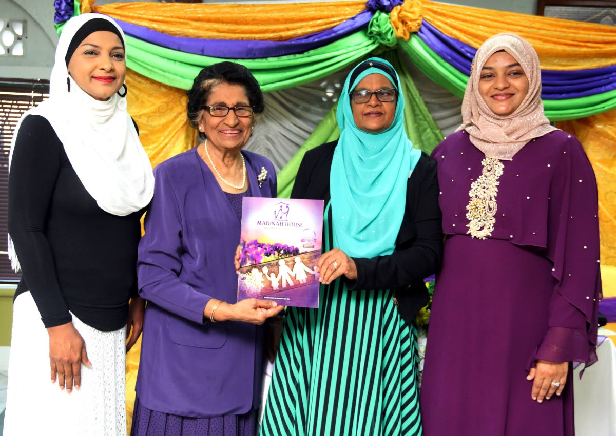 Assistant resident representative of the UNDP (TT) Sharifa Ali-Abdullah, (left to right) Zalayhar Hassanali, Madinah House president Lydia Choate and Sabeerah Maryann Khan share the stage at the launch of a commemorative magazine, which celebrates Madinah House's 20th anniversary, at the Prince Albert Street Mosque, San Fernando yesterday. PHOTOS BY ANSEL JEBODH