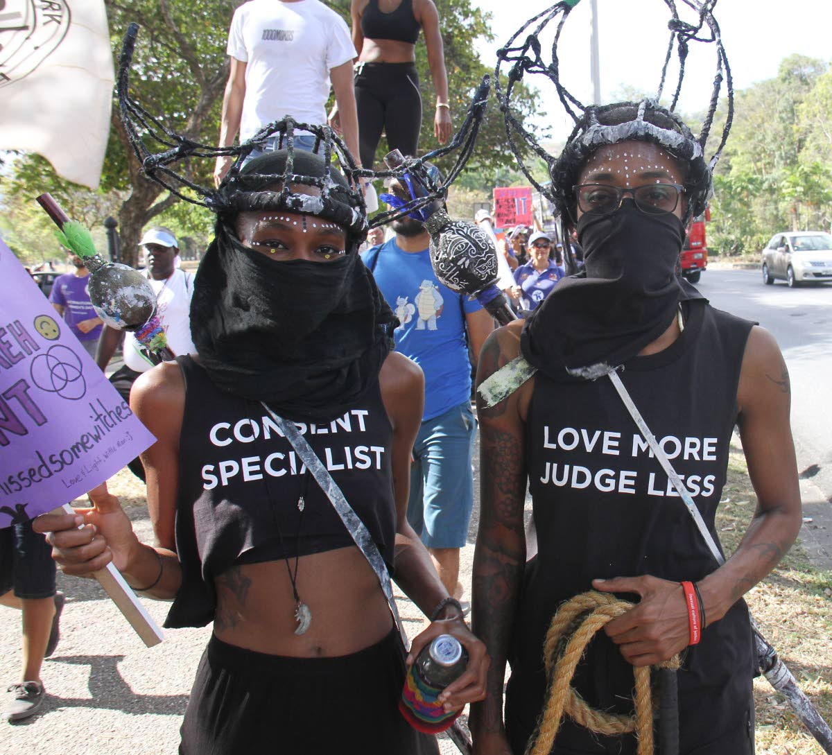 Activists in costume share the message of women's rights during march and rally at Queen's Park Savannah, Port of Spain yesterday, in observance of International Women's Day which was Friday. PHOTO BY ANGELO MARCELLE