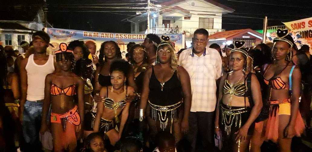Chairman of the Sangre Grande Regional Corporation Terry Rondon poses with masqueraders on Carnival Tuesday as the corporation hosted one of its most successful and safest Carnival celebrations.